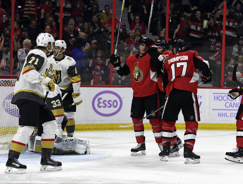 Nov 4, 2017; Ottawa, Ontario, CAN; Ottawa Senators forward Alexandre Burrows (14) reacts with teammates after scoring a goal against the Vegas Golden Knights during the second period at Canadian T ...