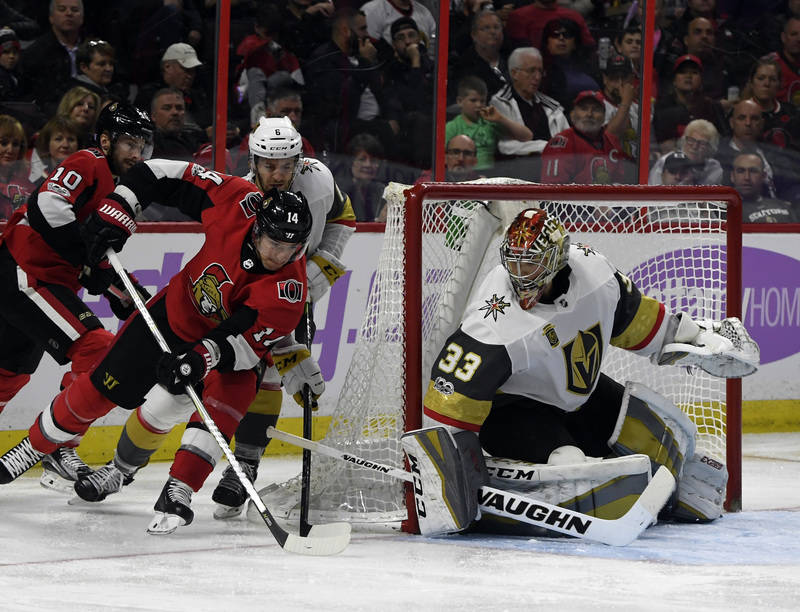 Nov 4, 2017; Ottawa, Ontario, CAN; Ottawa Senators forward Alexandre Burrows (14) scores a goal against Vegas Golden Knights goalie Maxime Lagace (33) during the second period at Canadian Tire Cen ...