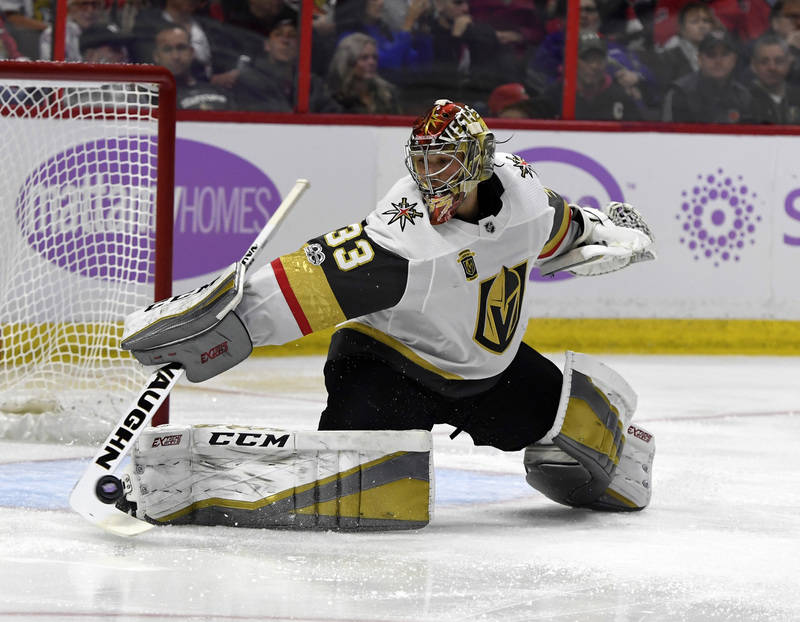 Nov 4, 2017; Ottawa, Ontario, CAN; Vegas Golden Knights goalie Maxime Lagace (33) makes a save during the second period of the game against the Ottawa Senators at Canadian Tire Centre. Mandatory C ...