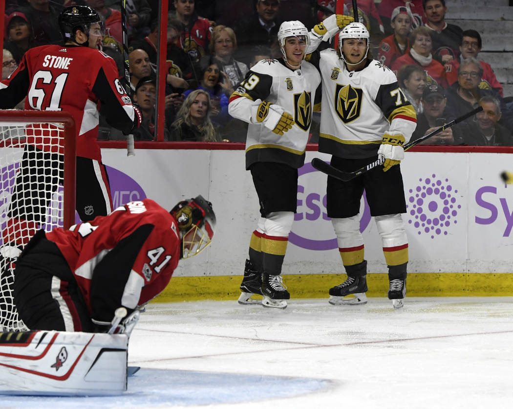 Nov 4, 2017; Ottawa, Ontario, CAN; Vegas Golden Knights forward William Karlsson (71) reacts with teammate Reilly Smith (19) after scoring a goal against Ottawa Senators goalie Craig Anderson (41) ...