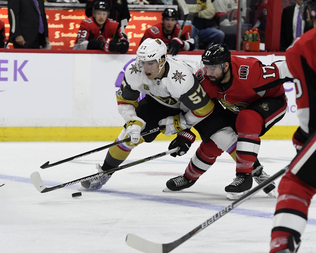 Nov 4, 2017; Ottawa, Ontario, CAN; Vegas Golden Knights forward David Perron (57) plays the puck and Ottawa Senators forward Nate Thompson (17) defends during the third period at Canadian Tire Cen ...