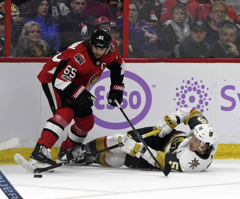 Nov 4, 2017; Ottawa, Ontario, CAN; Vegas Golden Knights forward Erik Haula (56) plays the puck and Ottawa Senators defenseman Erik Karlsson (65) defends during the first period at Canadian Tire Ce ...