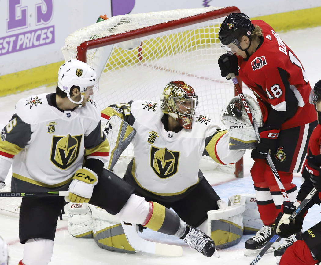 Vegas Golden Knights goalie Maxime Lagace (33) makes a glove save as defenseman Colin Miller (6) and Ottawa Senators left wing Ryan Dzingel (18) look on during the first period of an NHL hockey ga ...