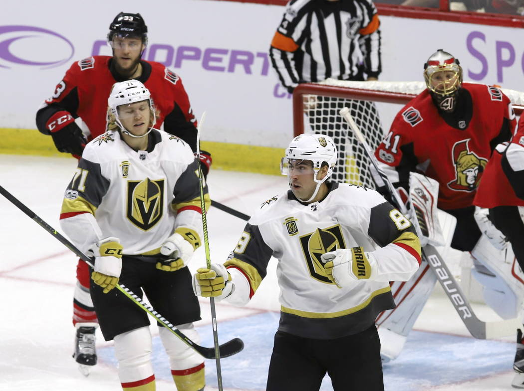 Vegas Golden Knights right wing Alex Tuch (89) celebrates his goal with center William Karlsson (71) as Ottawa Senators goalie Craig Anderson (41) and defenseman Fredrik Claesson (33) look on duri ...