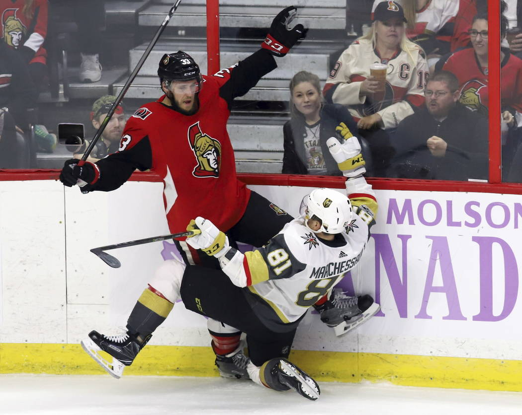 Ottawa Senators defenseman Fredrik Claesson (33) collides with Vegas Golden Knights center Jonathan Marchessault (81) during the second period of an NHL hockey game, Saturday, Nov. 4, 2017 in Otta ...