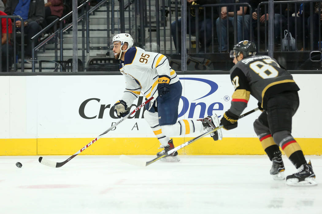 Buffalo Sabres right wing Justin Bailey (95) takes the puck up the ice as Vegas Golden Knights center Vadim Shipachyov (87) trails behind during a game at T-Mobile Arena in Las Vegas, Tuesday, Oct ...