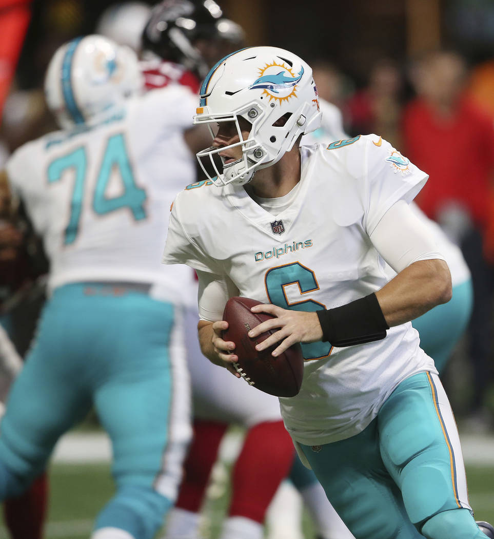 Miami Dolphins quarterback Jay Cutler (6) runs out of the pocket against the Atlanta Falcons during the first half of an NFL football game, Sunday, Oct. 15, 2017, in Atlanta. (AP Photo/ John Bazem ...