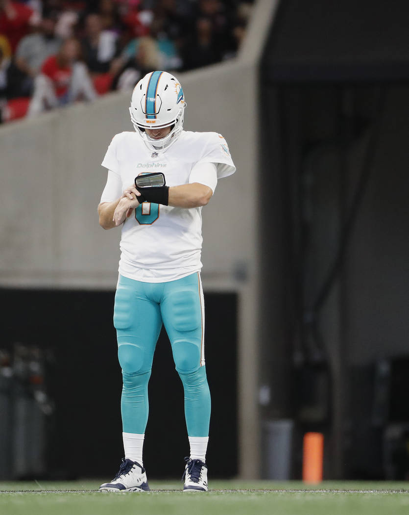 Miami Dolphins quarterback Jay Cutler (6) works against the Atlanta FalconsH during the first half of an NFL football game, Sunday, Oct. 15, 2017, in Atlanta. (AP Photo/David Goldman)