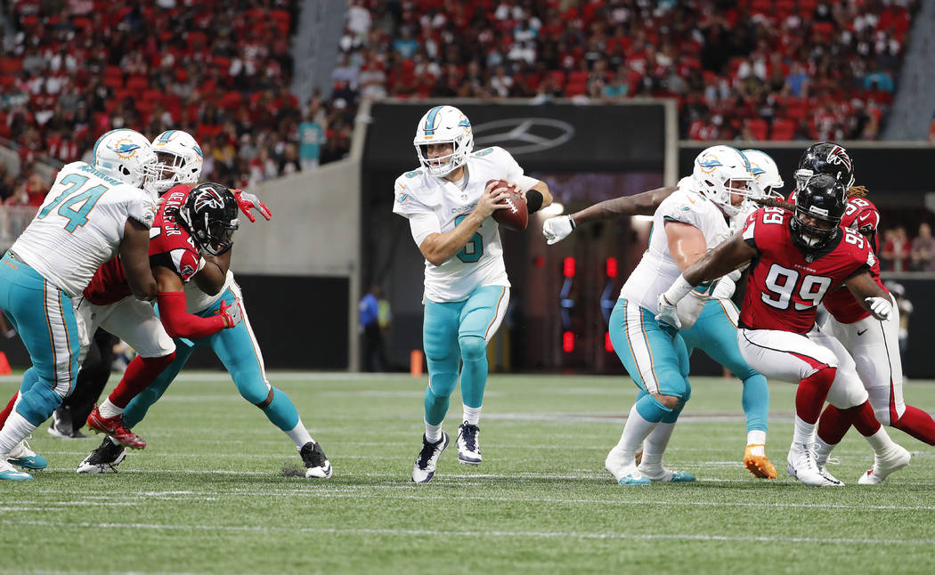 Miami Dolphins quarterback Jay Cutler (6) leaves the pocket against the Atlanta FalconsH during the second half of an NFL football game, Sunday, Oct. 15, 2017, in Atlanta. (AP Photo/David Goldman)