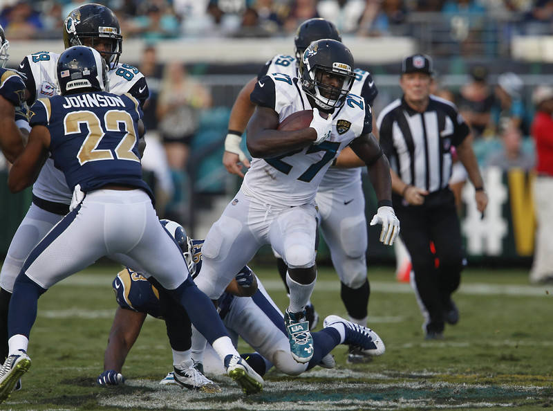 Oct 15, 2017; Jacksonville, FL, USA; Jacksonville Jaguars running back Leonard Fournette (27) runs past Los Angeles Rams cornerback Trumaine Johnson (22) during the second half of a football game  ...