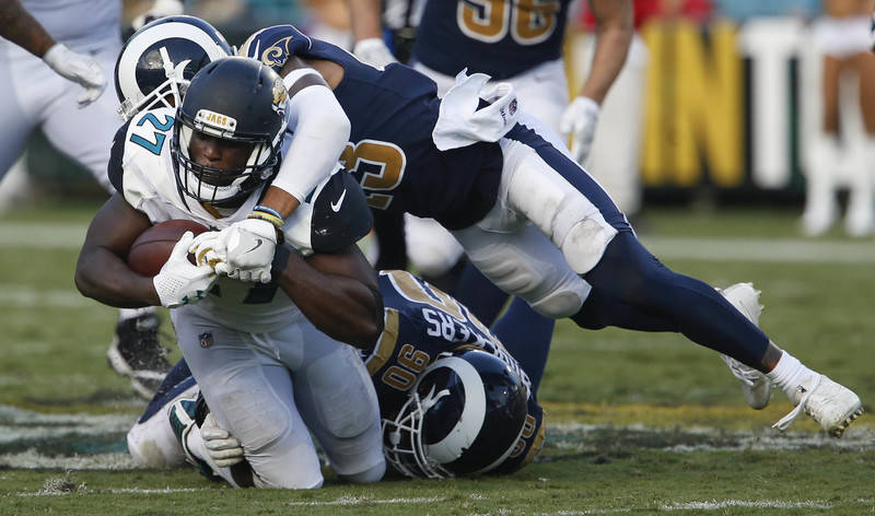 Oct 15, 2017; Jacksonville, FL, USA; Los Angeles Rams strong safety John Johnson (43) tackles Jacksonville Jaguars running back Leonard Fournette (27) during the second half of a football game at  ...