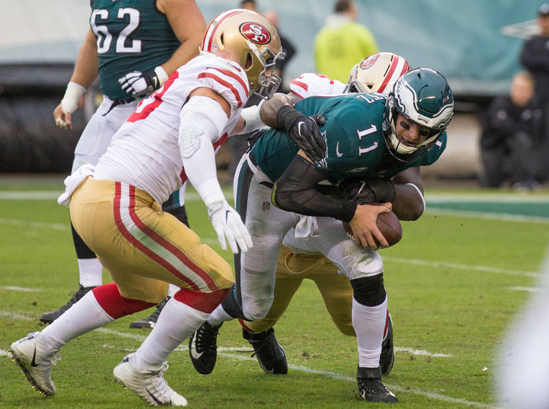 Oct 29, 2017; Philadelphia, PA, USA; Philadelphia Eagles quarterback Carson Wentz (11) is tackled by San Francisco 49ers middle linebacker Brock Coyle (50) and defensive tackle Earl Mitchell (90)  ...