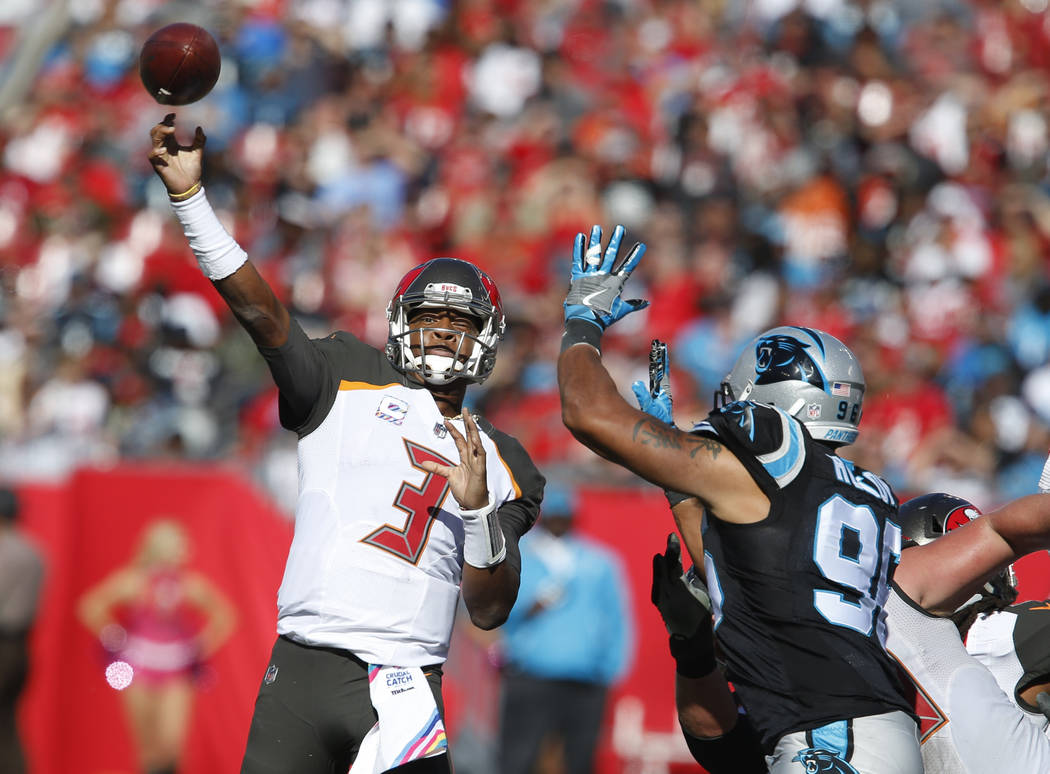 Oct 29, 2017; Tampa, FL, USA;Tampa Bay Buccaneers quarterback Jameis Winston (3) drops to throw a pass as Carolina Panthers defensive end Wes Horton (96) puts on the pressure during the second hal ...