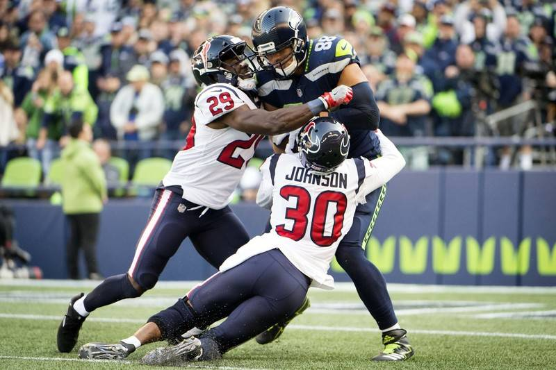 Oct 29, 2017; Seattle, WA, USA; Houston Texans free safety Andre Hal (29) and cornerback Kevin Johnson (30) tackle Seattle Seahawks tight end Jimmy Graham (88) during the second half at CenturyLin ...