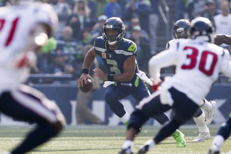 Oct 29, 2017; Seattle, WA, USA; Seattle Seahawks quarterback Russell Wilson (3) scrambles out of the pocket against the Houston Texans during the second quarter at CenturyLink Field. Joe Nicholson ...