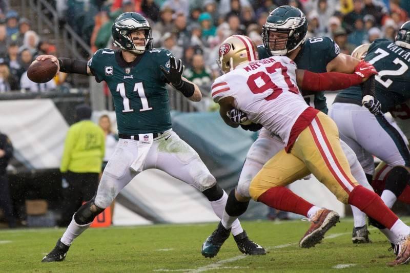 Oct 29, 2017; Philadelphia, PA, USA; Philadelphia Eagles quarterback Carson Wentz (11) passes in front of the rush of San Francisco 49ers linebacker Dekoda Watson (97) during the third quarter at  ...