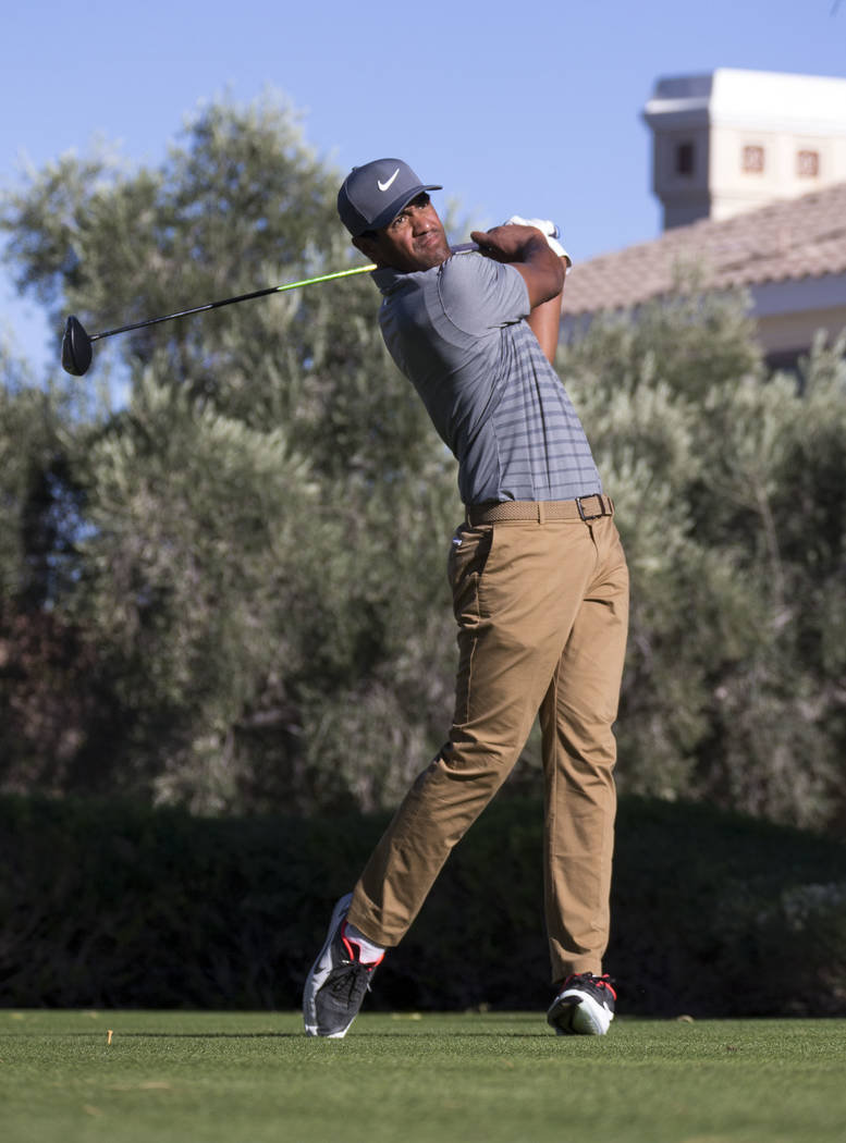 Tony Finau of Utah hits a tee shot on the 16th hole during the third round of the Shriners Hospitals For Children Open tournament at TPC at Summerlin in Las Vegas, Saturday, Nov. 4, 2017. Richard  ...