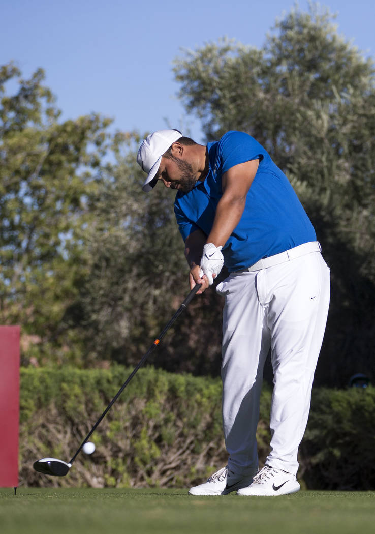 J.J. Spaun of California hits a tee shot on the 16th hole during the third round of the Shriners Hospitals For Children Open tournament at TPC at Summerlin in Las Vegas, Saturday, Nov. 4, 2017. Ri ...