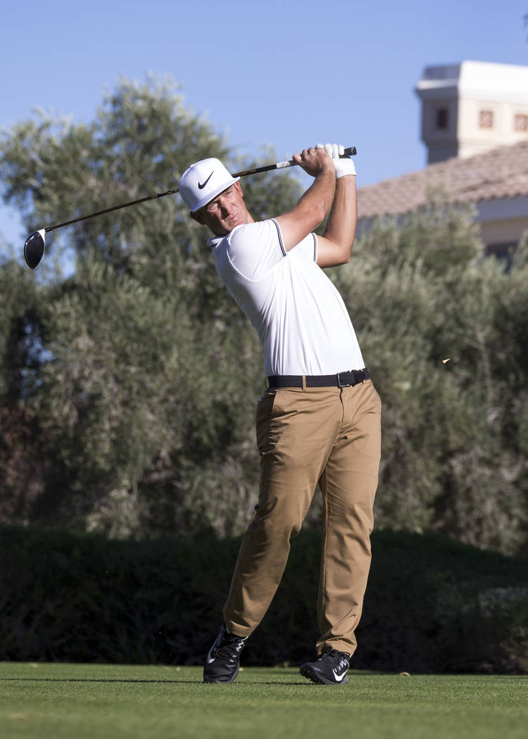 Kevin Chappell of California watches his tee shot on the 16th hole during the third round of the Shriners Hospitals For Children Open tournament at TPC at Summerlin in Las Vegas, Saturday, Nov. 4, ...