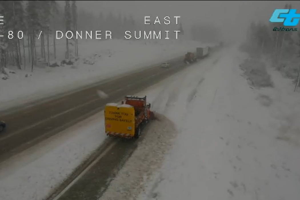 Remote video image released by Caltrans District 3 shows its plowers busy at work keeping Interstate 80 open at the summit in Donner Pass, Calif. (Caltrans District 3 via AP)