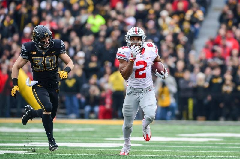 Nov 4, 2017; Iowa City, IA, USA; Ohio State Buckeyes running back J.K. Dobbins (2) runs the ball as Iowa Hawkeyes defensive back Jake Gervase (30) chases from behind during the second quarter at K ...