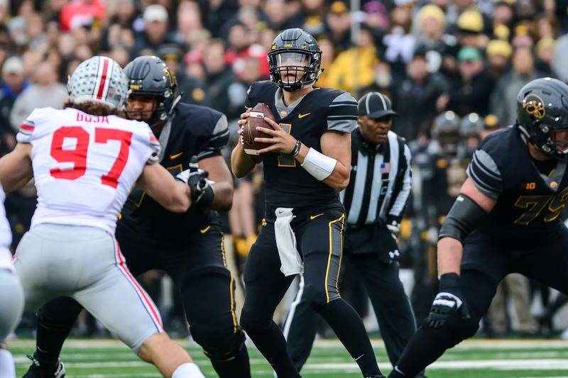 Nov 4, 2017; Iowa City, IA, USA; Iowa Hawkeyes quarterback Nathan Stanley (4) looks to throw a pass during the first quarter against the Ohio State Buckeyes at Kinnick Stadium. (Jeffrey Becker-USA ...