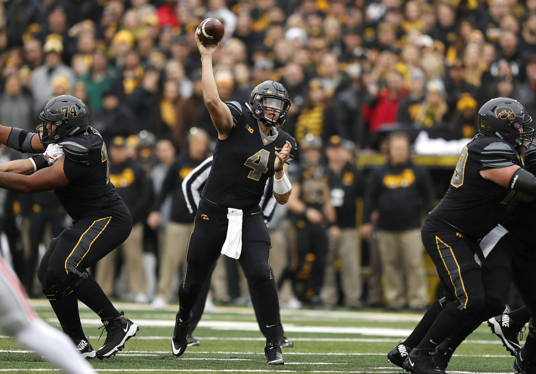 Iowa quarterback Nathan Stanley throws a pass during the first half of an NCAA college football game against Ohio State, Saturday, Nov. 4, 2017, in Iowa City, Iowa. (AP Photo/Charlie Neibergall)