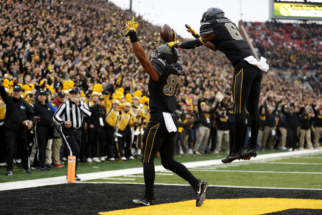 Iowa tight end Noah Fant (87) celebrates with teammate Ihmir Smith-Marsette after catching a 3-yard touchdown pass during the first half of an NCAA college football game against Ohio State, Saturd ...