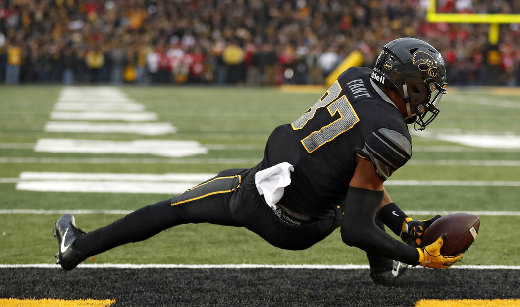 Iowa tight end Noah Fant catches a three-yard touchdown pass during the first half of an NCAA college football game against Ohio State, Saturday, Nov. 4, 2017, in Iowa City, Iowa. (AP Photo/Charli ...