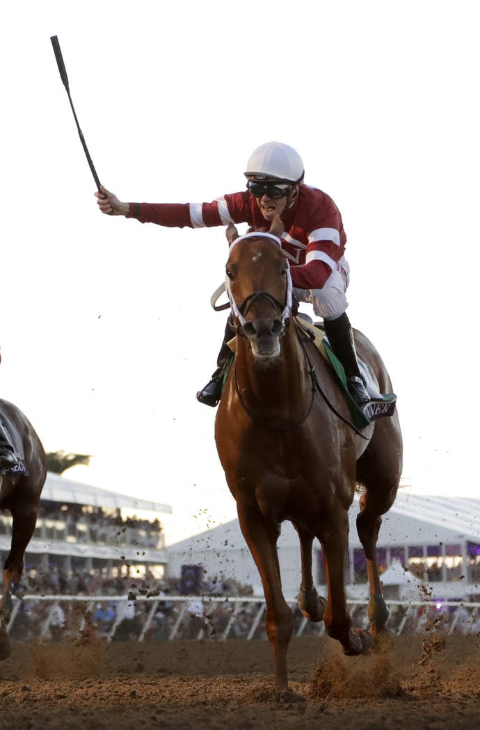 Florent Geroux celebrates after riding Gun Runner to victory in the Classic during the Breeders' Cup horse races, Saturday, Nov. 4, 2017, at Del Mar Thoroughbred Club in Del Mar, Calif. (AP Photo/ ...