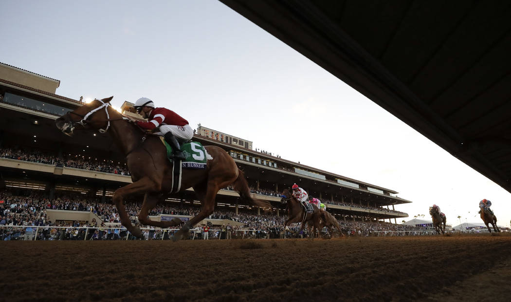 Florent Geroux rides Gun Runner to victory in the Classic horse race during the Breeders' Cup, Saturday, Nov. 4, 2017, in Del Mar, Calif. (AP Photo/Gregory Bull)
