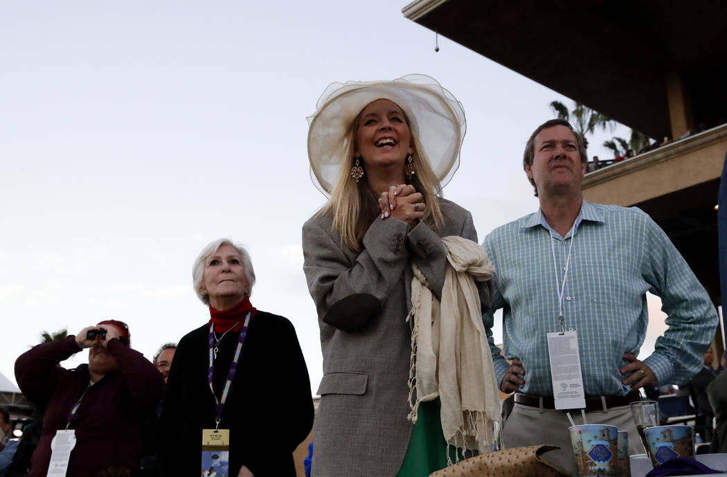 Fans watch as Gun Runner rides victory in the Classic horse race during the Breeders' Cup, Saturday, Nov. 4, 2017, in Del Mar, Calif. (AP Photo/Chris Carlson)