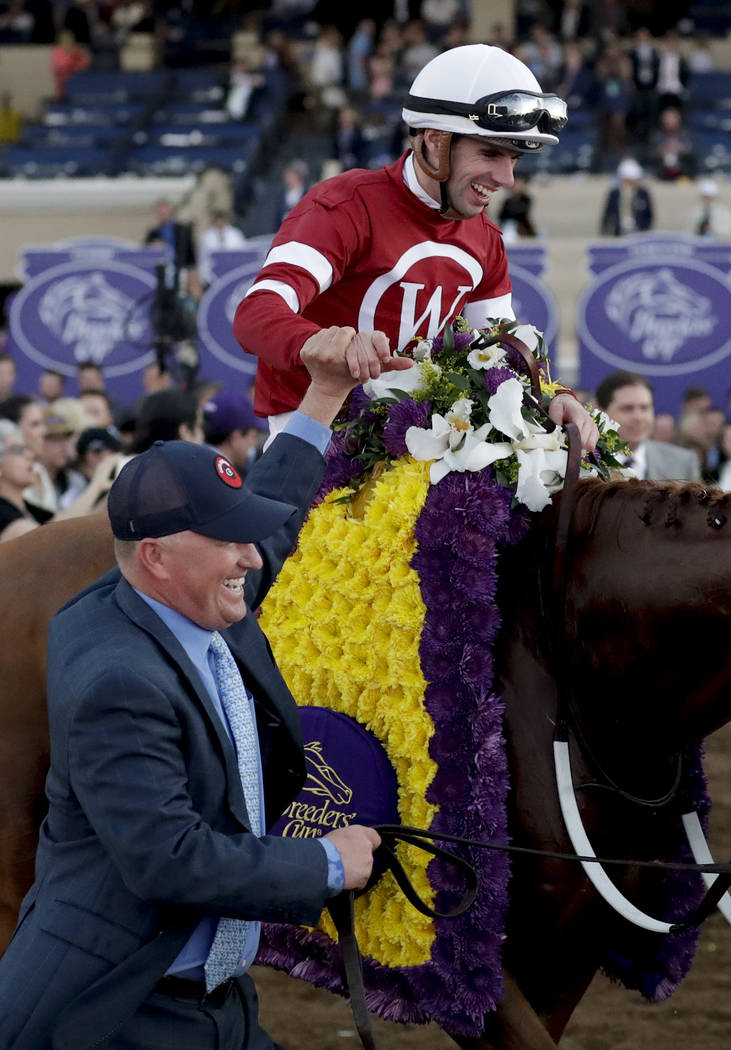Florent Geroux celebrates after riding Gun Runner to victory in the Classic during the Breeders' Cup horse races, Saturday, Nov. 4, 2017, in Del Mar, Calif. (AP Photo/Gregory Bull)