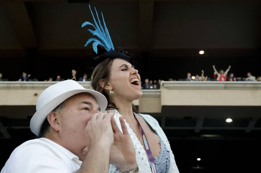 Fans watch as Gun Runner wins the Classic during the Breeders' Cup horse races, Saturday, Nov. 4, 2017, at Del Mar Thoroughbred Club in Del Mar, Calif. (AP Photo/Chris Carlson)