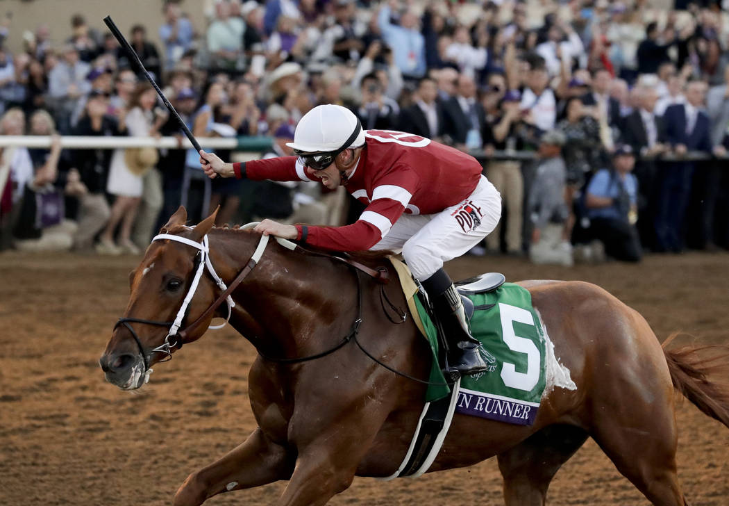 Florent Geroux celebrates after riding Gun Runner to victory in the Classic horse race during the Breeders' Cup, Saturday, Nov. 4, 2017, in Del Mar, Calif. (AP Photo/Gregory Bull)