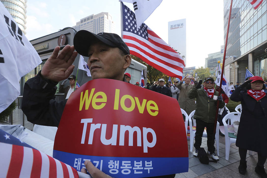 Protesters against North Korea salute during a rally welcoming the planned visit by U.S. President Donald Trump in Seoul, South Korea, Saturday, Nov. 4, 2017. (AP Photo/Ahn Young-joon)