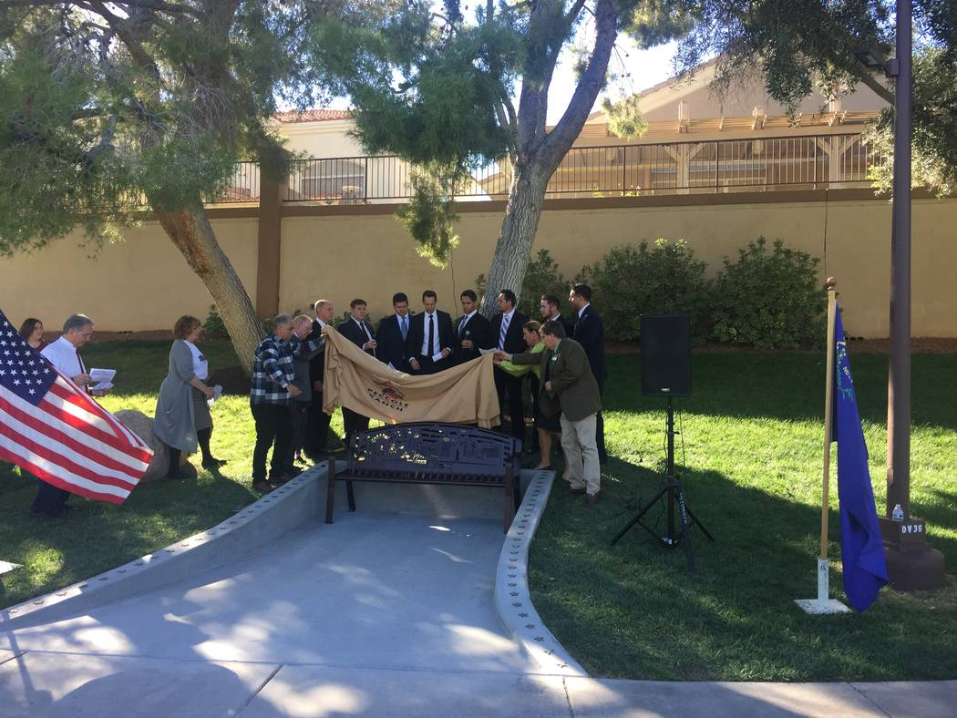 Members of the Peccole Ranch Community Association board and others unveil a commemorative bench during a ceremony Saturday afternoon, Nov. 4, 2017, in western Las Vegas.