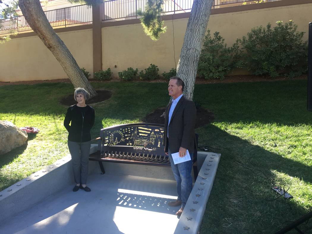 Clark County Commissioner Susan Brager and Nevada Lt. Gov. Mark Hutchison flank a commemorative bench dedicated Saturday afternoon at the Peccole Ranch community in western Las Vegas.