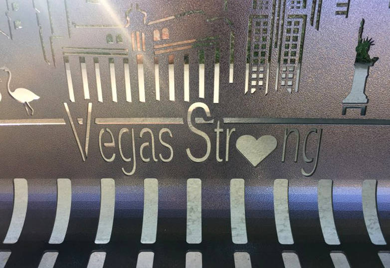 Sunlight streams through a portion of the newly dedicated bench along a walking trail at the Peccole Ranch community in western Las Vegas. The bench, commemorating the victims of the Las Vegas sho ...
