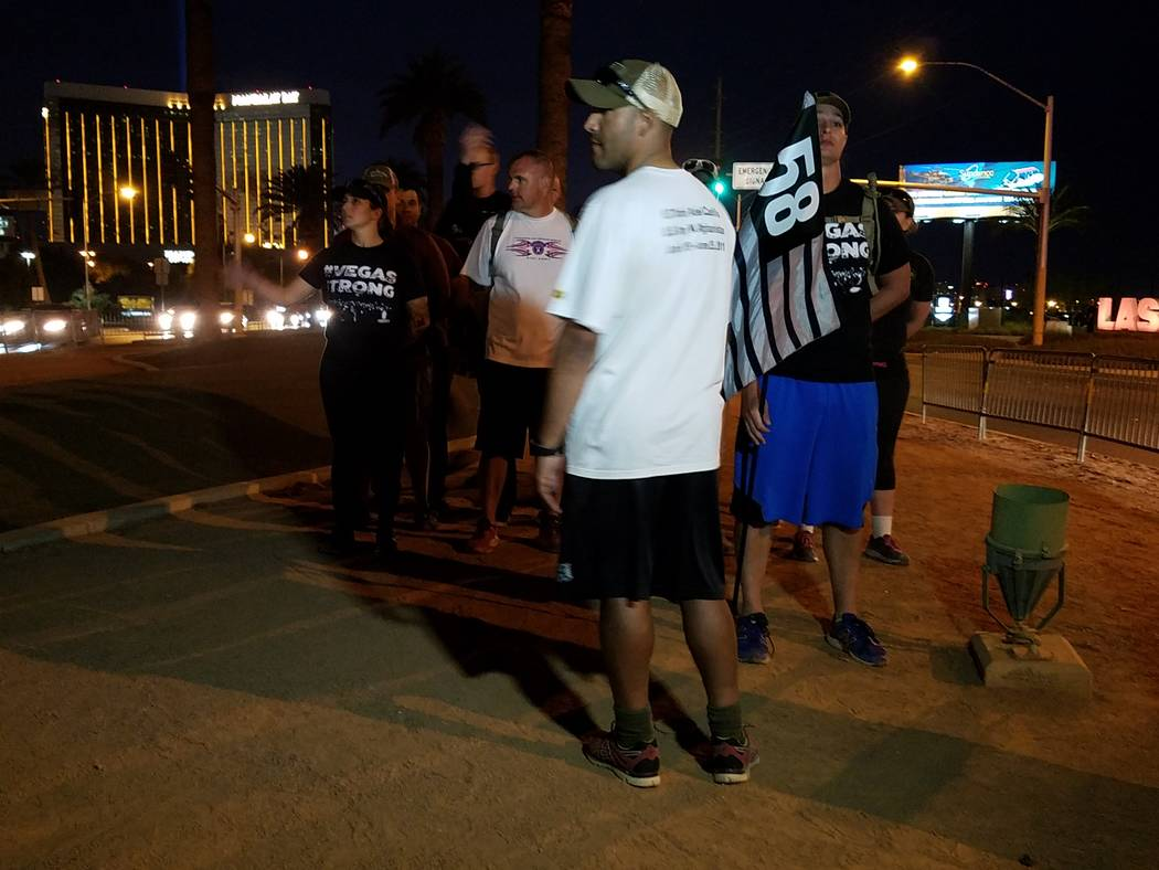 Active military members marched 58 miles along Las Vegas Boulevard over two days to raise money for the Las Vegas Victims Fund. They finished their journey by placing personalized dog tags on each ...