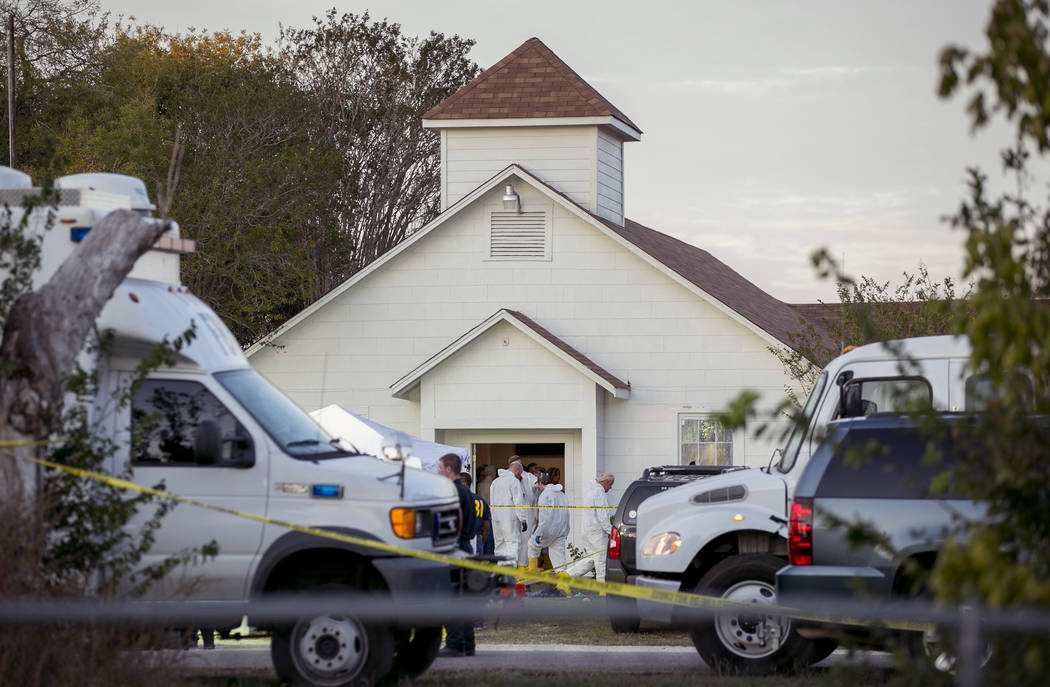 Investigators work at the scene of a mass shooting at the First Baptist Church in Sutherland Springs, Texas, on Sunday Nov. 5, 2017. A man opened fire inside of the church in the small South Texas ...