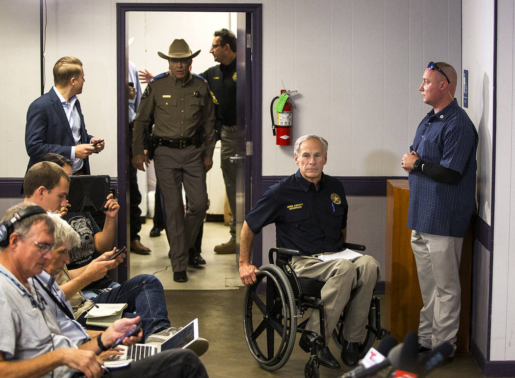 Texas Gov. Greg Abbott arrives to the Stockdale Community Center to address members of the media about a deadly shooting at the First Baptist Church in Sutherland Springs, during a press conferenc ...
