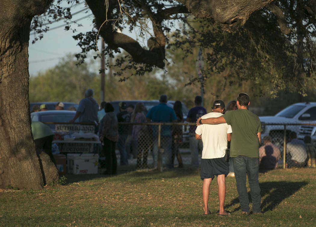 People comfort each other at a community center near the scene of a deadly shooting at the First Baptist Church in Sutherland Springs, Texas, Sunday, Nov. 5, 2017. A man opened fire inside of the  ...