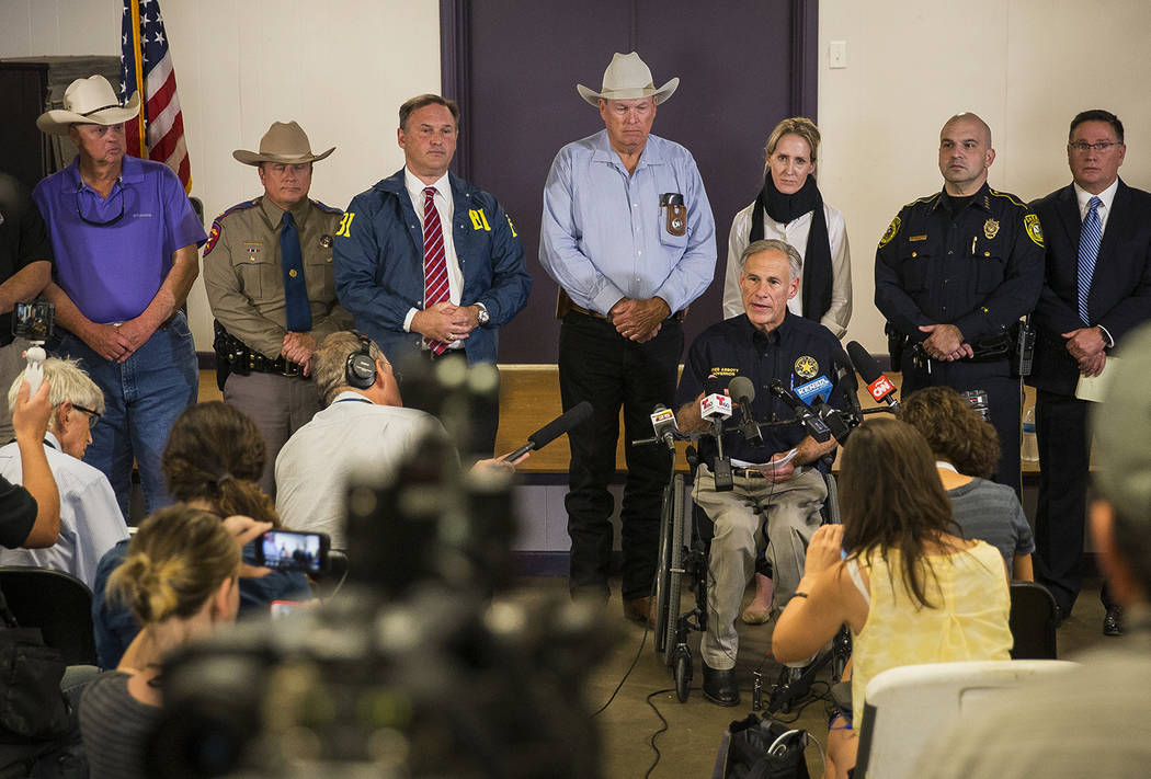 Texas Gov. Greg Abbott addresses members of the media about a deadly shooting at the First Baptist Church in Sutherland Springs, during a press conference in Stockdale, Texas, Sunday, Nov. 5, 2017 ...