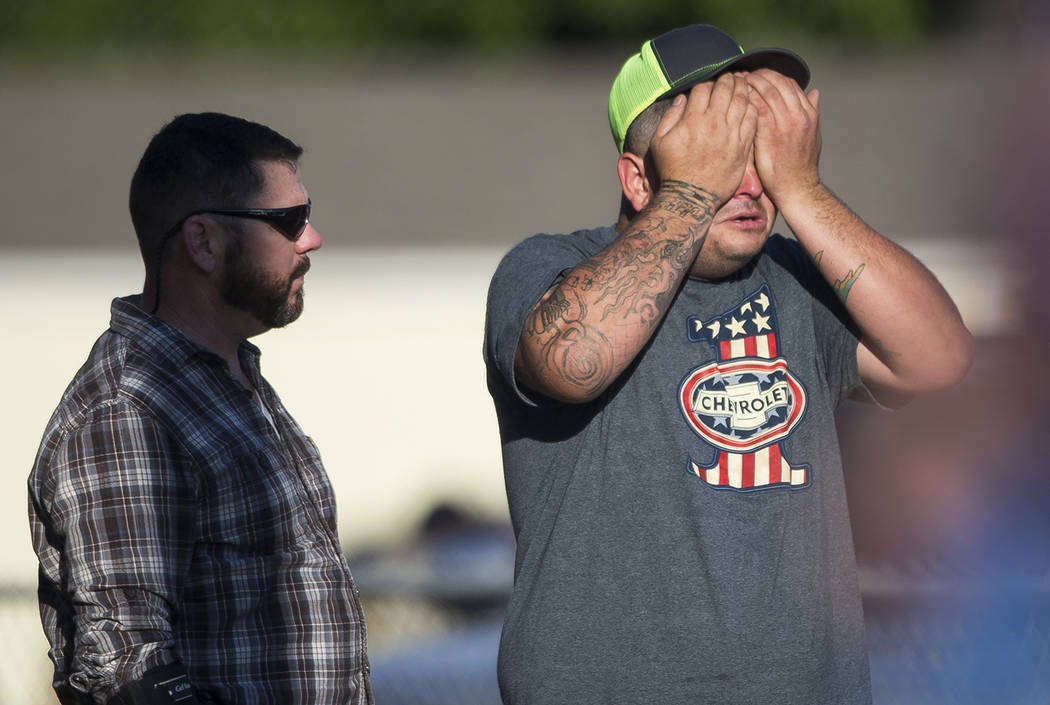 A man wipes his eyes after a deadly shooting at the First Baptist Church in Sutherland Springs, Texas, Sunday, Nov. 5, 2017. A man opened fire inside of the church in the small South Texas communi ...