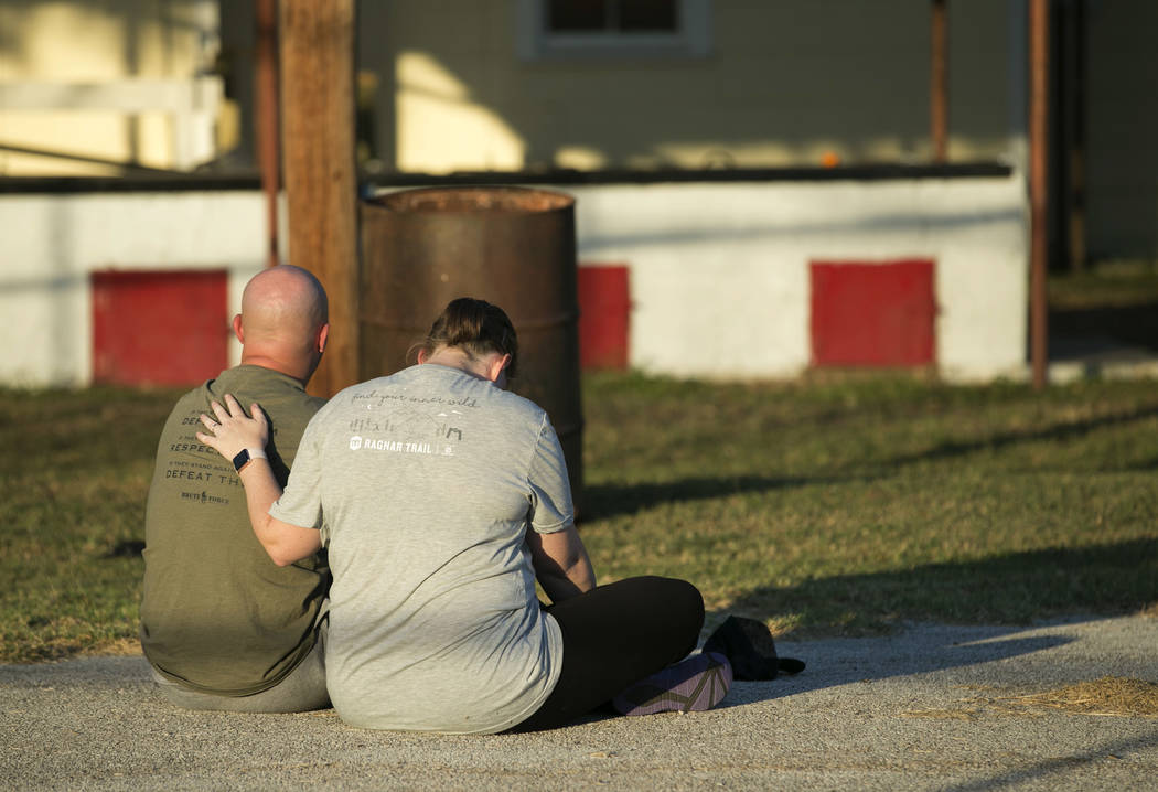 A couple comfort each other at a community center in Sutherland Springs, Texas, near the scene of a mass shooting at the First Baptist Church on Sunday, Nov. 5, 2017. A man opened fire inside of t ...