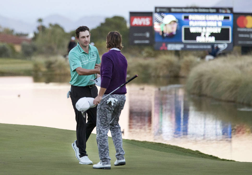Patrick Cantlay, left, of California shakes hands with Alex Cejka of Germany after the final round of the Shriners Hospitals For Children Open at TPC at Summerlin in Las Vegas, Sunday, Nov. 5, 201 ...