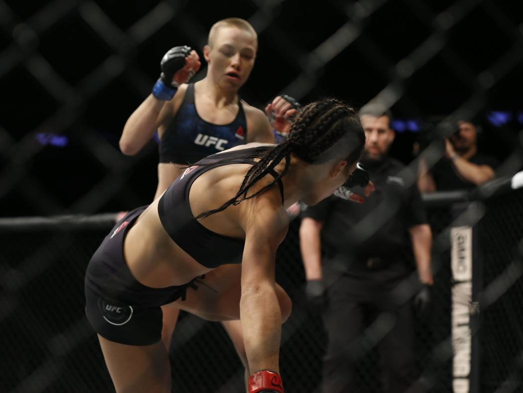 Nov 4, 2017; New York, NY, USA;  Rose Namajunas (blue gloves) fights Joanna Jedrzejczyk (red gloves) during UFC 217 at Madison Square Garden. (Noah K. Murray-USA TODAY Sports)