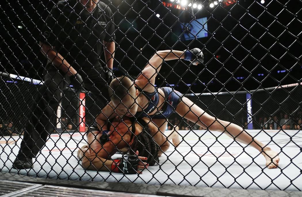 Nov 4, 2017; New York, NY, USA;  Rose Namajunas (blue gloves) fights Joanna Jedrzejczyk (red gloves) during UFC 217 at Madison Square Garden. (Noah K. Murray-USA TODAY Sports)