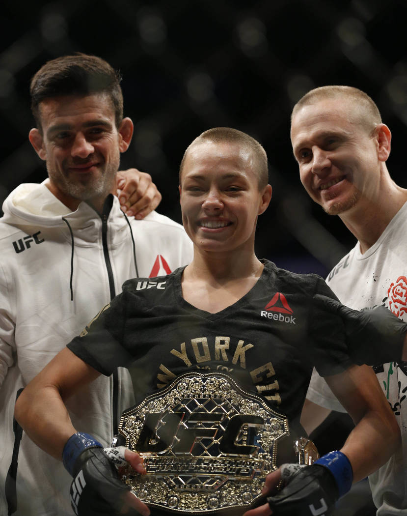 Nov 4, 2017; New York, NY, USA;  Rose Namajunas (blue gloves) celebrates with the belt after defeating Joanna Jedrzejczyk (red gloves) during UFC 217 at Madison Square Garden. (Noah K. Murray-USA  ...